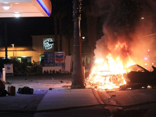 Burning wreckage from the police chase that killed Cathedral City police Officer Jermaine Gibson on March 18, 2011. This vehicle was driven by Durjan Gray.