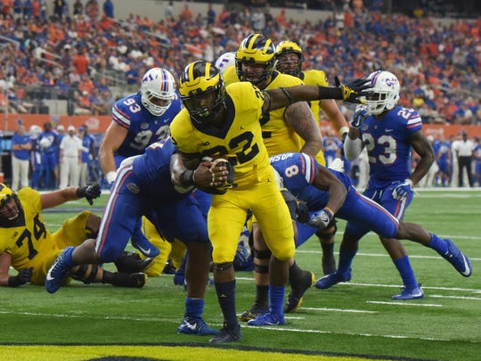 Michigan running back Karan Higdon is third on the team with 136 yards rushing this season.