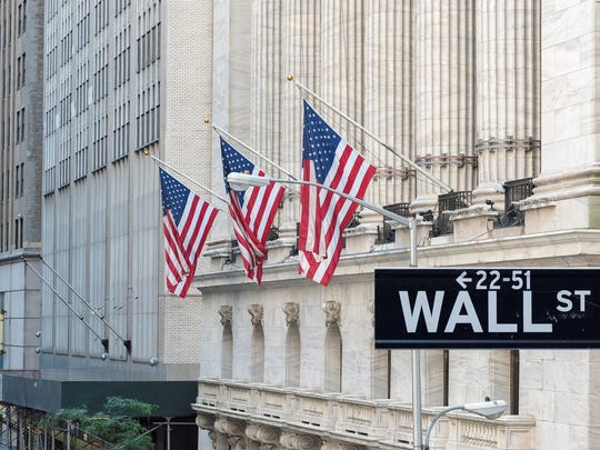 Wall Street sign outside New York Stock Exchange
