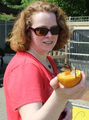 Amy Luke with one of the released butterflies.