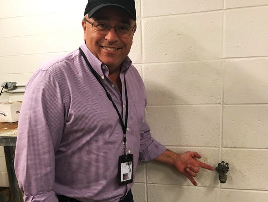 City Utility Administrator Perry Hart shows a backflow