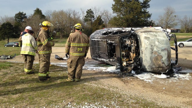 Three people who happened upon the scene saved Lisa Vogel, 59, of Mountain Home, from this burning 2008 Ford Escape along U.S. 62 in Gassville on Sunday afternoon.