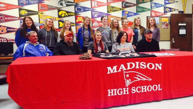 Madison's softball team gathered for senior Sam Gosnell's college signing in January.