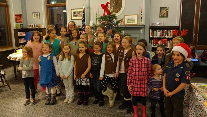 Children singing at the Groton Public Library on Dec. 8.