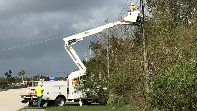 Electric crews on the job on 37th Street and Indian River Blvd.