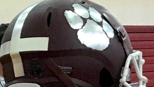 Fort Pierce Westwood High School football players sported new helmets for the first day of practice on Monday.