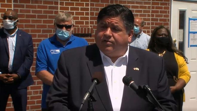 Gov. JB Pritzker announces the expansion of two programs that provide financial relief to low-income families and individuals, including those impacted by the COVID-19 pandemic, during a public appearance Monday in Belleville.