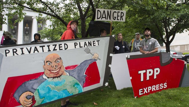 Demonstrators protest against the legislation to give President Obama fast-track authority to advance trade deals, including the Trans-Pacific Partnership, during a protest march on Capitol Hill in Washington on May 21, 2015.