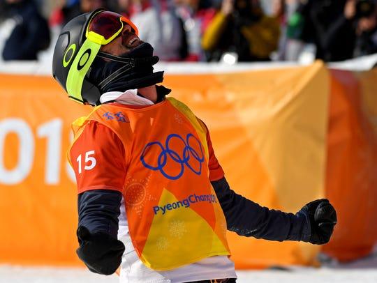 USA's Nick Baumgartner reacts in the Mens Snowboardcross