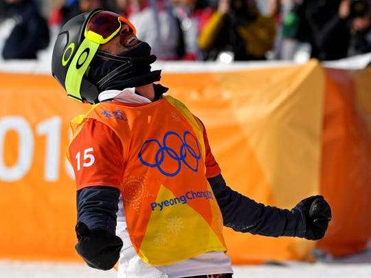 USA's Nick Baumgartner reacts in the Mens Snowboardcross