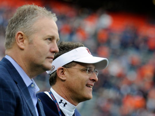 Auburn Athletic Director Jay Jacobs (left) and head