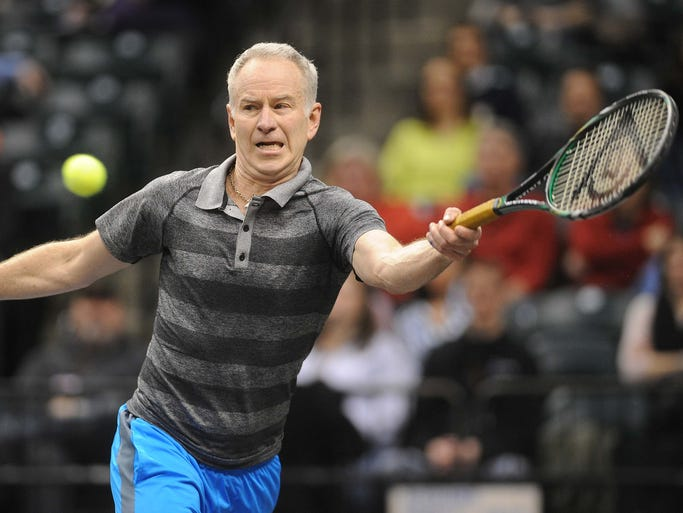 John McEnroe hits a forehand on his way to defeating Ivan Lendl in a PowerShares Tennis match at Bankers Life Fieldhouse Friday February 14, 2014.