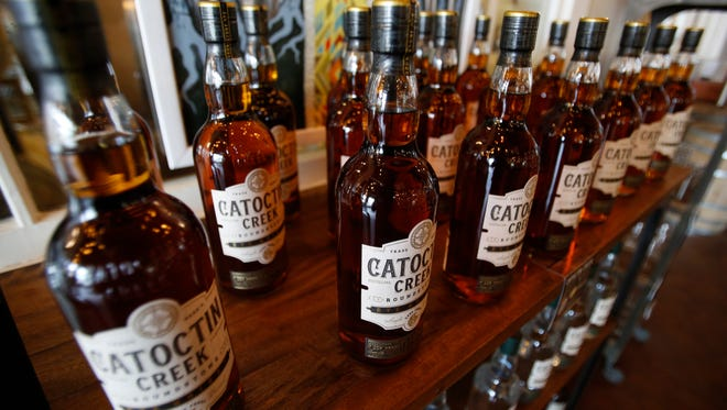 Catoctin Creek Distillery whiskey is on display in the tasting room in Purcellville, Virginia. The European Union on Friday will start taxing a range of U.S. imports, including Harley-Davidson bikes, cranberries, peanut butter, playing cards and whiskey.