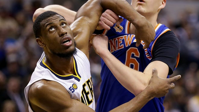 Indiana Pacers forward Thaddeus Young (21) and New York Knicks forward Kristaps Porzingis (6) fights for position for a rebound in the second half of their game Monday, January 23, 2017, evening at Bankers Life Fieldhouse. The Pacers lost to the Knicks 109-103.