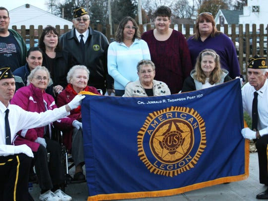 The family of Jerrald R. Thompson poses with members of the local American Legion post. The post changed its name to honor Thompson, who received both the Navy Cross and the Purple Heart for the heroism he displayed while fighting in Vietnam.