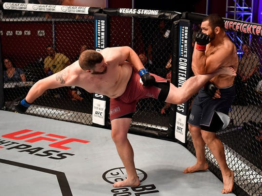 Howell's Josh Parisian kicks Greg Rebello in their heavyweight bout during Dana White's Tuesday Night Contender Series at the TUF Gym on June 26, 2018 in Las Vegas, Nevada.