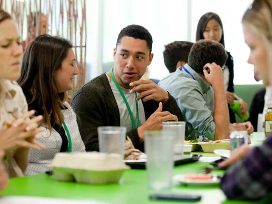 Employees socialize at Google's cafeteria, one of the