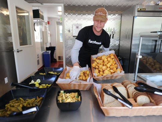 A Facebook food service worker serving up lunchtime