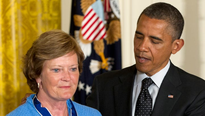 In this May 29, 2012, file photo, President Obama awards Pat Summitt, former Tennessee basketball head coach, the Presidential Medal of Freedom in the East Room of the White House. Summitt, the winningest coach in Division I college basketball history who uplifted the women's game from obscurity to national prominence during her career at Tennessee, died Tuesday morning. She was 64.