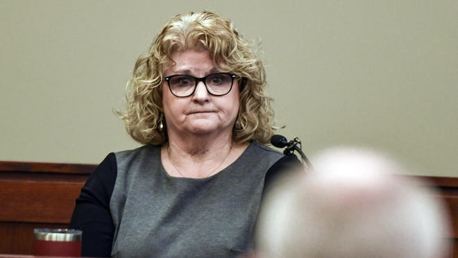 In this Feb. 14, 2020, file photo, former Michigan State gymnastics coach Kathie Klages testifies in Lansing, Mich. Klages is scheduled to be sentenced Tuesday, Aug. 4, 2020, for lying to police during an investigation into ex-Olympic and university sports doctor Larry Nassar.
