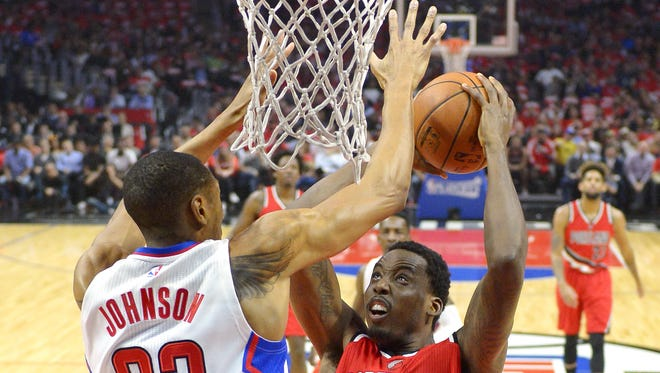 Portland Trail Blazers forward Al-Farouq Aminu, right, shoots as Los Angeles Clippers forward Wesley Johnson defends during the first half in Game 5 of a first-round NBA basketball playoff series, Wednesday, April 27, 2016, in Los Angeles.