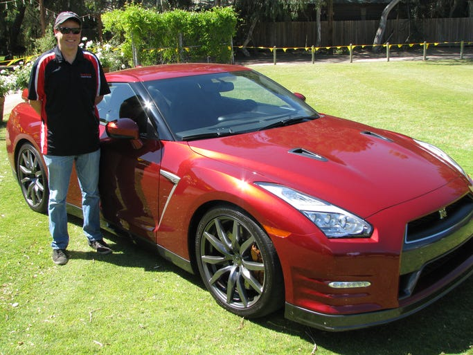 That golden glint next to Nissan spokesman Dan Passe is what he says is real gold in the red paint of that GT-R.