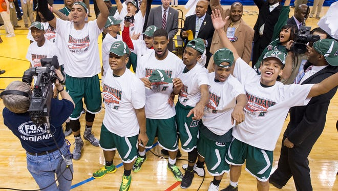 Arsenal Tech celebrates after winning the IHSAA Boys Basketball 4A State Finals at Bankers Life Fieldhouse, Saturday, March 29, 2014. Arsenal Tech defeated Lake Central 63-59.
