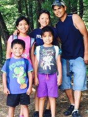 Lorenzo Moreno poses with his family.