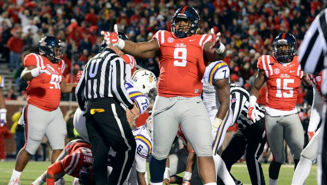 Ole Miss defensive tackle Breeland Speaks celebrates a play during the Rebels' game against LSU. The Rebels are heading to the Sugar Bowl on a decidedly different path than Oklahoma State.
