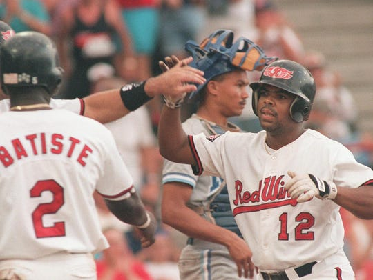 Rochester's Rod Robertson collects high-fives from