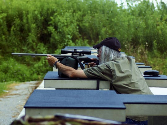 The author works at sighting in his Inline gun.
