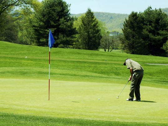 """The author putts on a green at a golf course designated as """"Audubon Certified."""""""