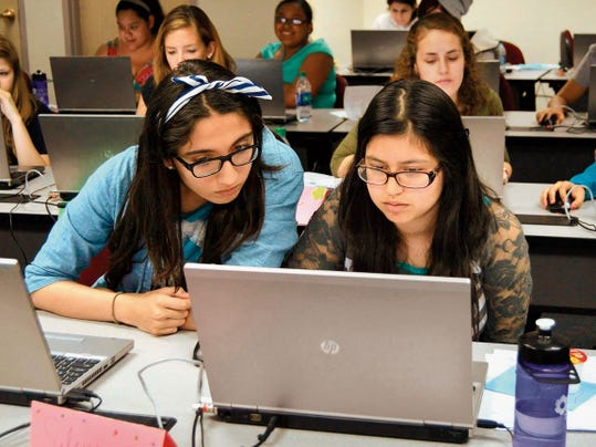 Courtesy Photo   From left: Azul Toledo and Selene De Luna are participating in NMSU's Young Women Growing Up Thinking Computationally summer camp program. The students were coding in Python to create a program that will run encryptions using ROT13. The project is a way for them to learn the language and create challenging and engaging projects.