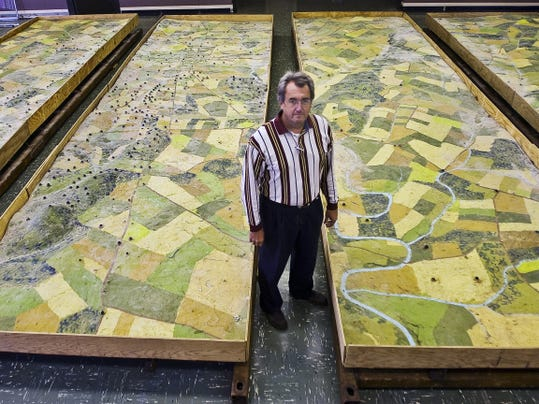 Scott Roland stands beside the Gettysburg Electric Map after the last two sections of the map were moved into the old Wachovia Bank in Hanover in 2012.