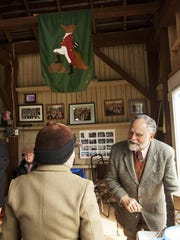 "John Patteson gathers with other riders in the clubhouse after a fox hunt on Wednesday, March 13, 2013, in Middlebrook. After a hunt, riders typically gather for ""tea,"" which rarely includes tea, but features snacks and drinks."