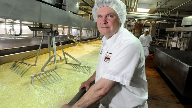 Roger Krohn, a cheese maker with Agropur Inc., is pictured by finishing tables at the company's Luxemburg area plant in 2010. Agropur is among many dairy companies in Northeastern Wisconsin seeking workers.