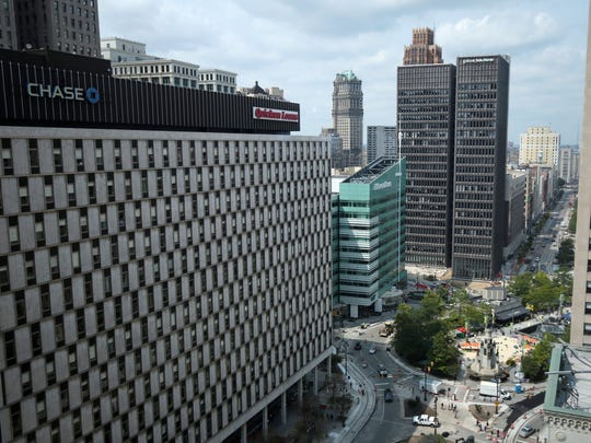 On the left is Chase Tower owned by Bedrock Real Estate Services which is now home for the Quicken Loans. The view is looking north on Woodward from One Detroit Center in August  2015, in Detroit.