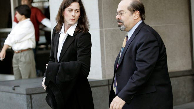 In this Friday, Jan. 19, 2007, file photo,  former elite cyclist Tammy Thomas, left, leaves the federal courthouse with her attorney Tony Tamburello in San Francisco. Thomas was a bit player in the infamous Bay Area-based sports doping scandal that ensnared Barry Bonds and a host of other big-name athletes.