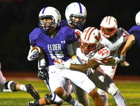 Elder's Kyle Trischler tries to break a tackle against West.