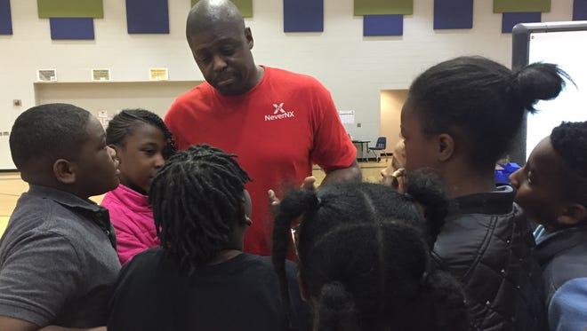 Shaun Golden is surrounded by students after presenting his Golden Opportunity program at Sterling School in Greenville March 23.
