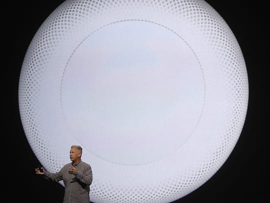 Apple's Senior Vice President of Worldwide Marketing Phil Schiller announces Apple's latest product, HomePod, a wireless speaker device, during the opening keynote address the 2017 Apple Worldwide Developer Conference (WWDC) at the San Jose Convention Center on June 5, 2017 in San Jose.