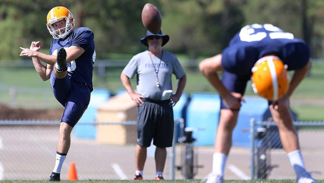 Australian kicker Mitchell Crawford works on his American football skills under the watchful eye of Special Teams coordinator Joe Robinson during Camp Ruidoso recently. Crawford gives UTEP the edge in special teams over Northern Arizona.