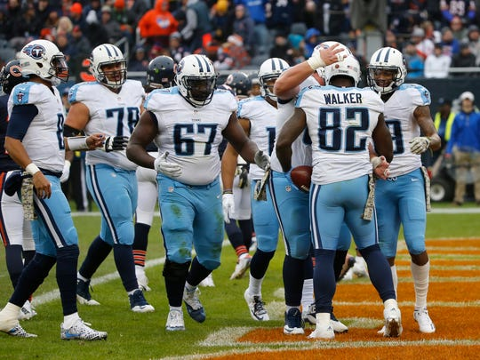 Tennessee Titans tight end Delanie Walker (82) celebrates a touchdown with his teammates during the first half of an NFL football game against the Chicago Bears, Sunday, Nov. 27, 2016, in Chicago.