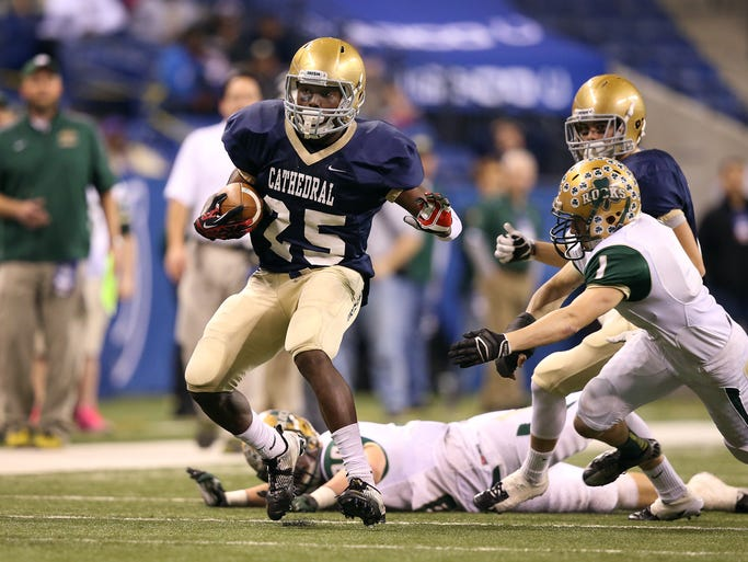 Cathedral's Terry McLaurin,#25, runs through the Shamrock defense. Cathedral fighting Irish play the Westfield Shamrcks in the IHSAA Class 5A football championship game Friday, November 29, 2013, afternoon at Lucas Oil Stadium.  Matt Kryger / The Star