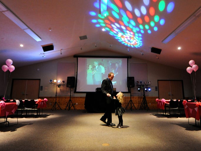 Mike Oisten and his daughter Morgan, 5, have the dance floor to themselves during the Daddy Daughter Valentine Dance at the Cool Creek Nature Center, Thursday, February 6, 2014, in Carmel. The annual event is sponsored by Hamilton County Parks & Recreation.