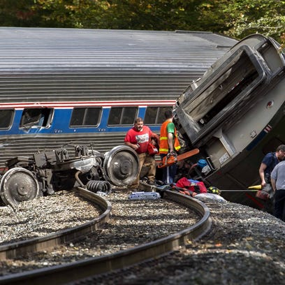 Public safety officials work at the scene of an Amtrak