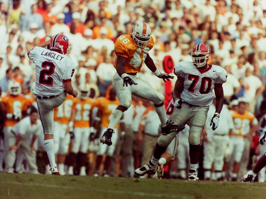 UT's Raynoch Thompson (46) attempts to block a punt by Georgia's Dax Langley on October 11, 1997 at Neyland Stadium. Photo by Joe Howell/News Sentinel