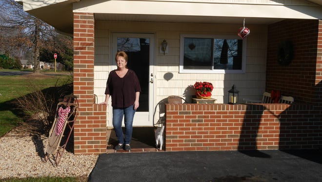 """Roxanne Short poses outside her home in Stuarts Draft. She writes the """"In The Draft"""" Facebook page."""