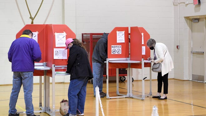 Voters cast their ballots at the North Carolina Justice Academy in Edneyville on Election Day, Nov. 3, 2020.