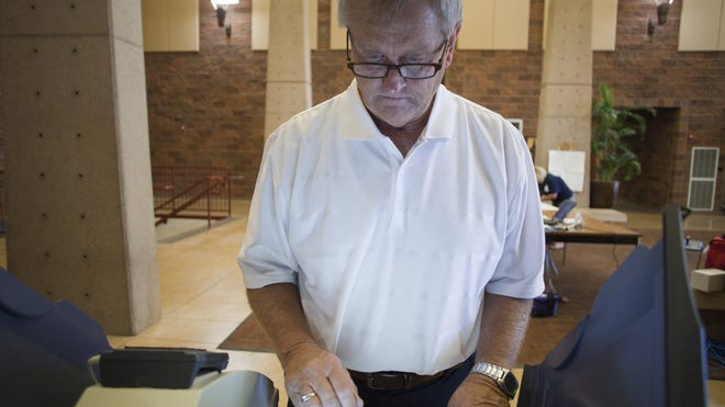 Cedar City resident Dennis Anderson places his vote in Tuesday's Republican primary election at Cedar High School.